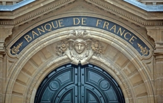 A sign for the Banque de France, also known as the Bank of France, sits above the bank's entrance in Paris, France, on Wednesday, Jan. 18, 2012. Bank of France Governor Christian Noyer said ''numerous problems'' need to be resolved before a European tax on financial transactions can be implemented, indicating he's skeptical of President Nicolas Sarkozy's unilateral push to enact such a levy. Photographer: Balint Porneczi/Bloomberg