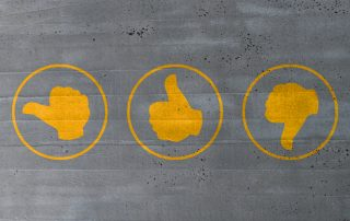 thumb valuation icons on cement concept.